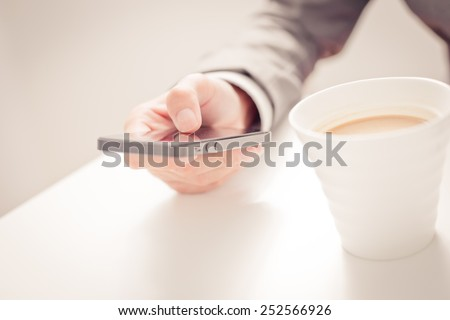 business, technology and internet concept - close up of man hands with coffee