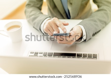 business, technology and internet concept - close up of man hands with coffee and laptop computer - stock photo