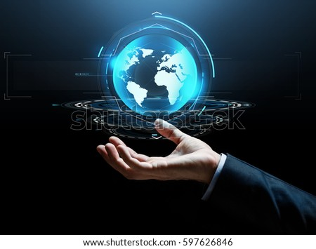 business, technology and people concept - close up of businessman hand with virtual earth projection over dark background