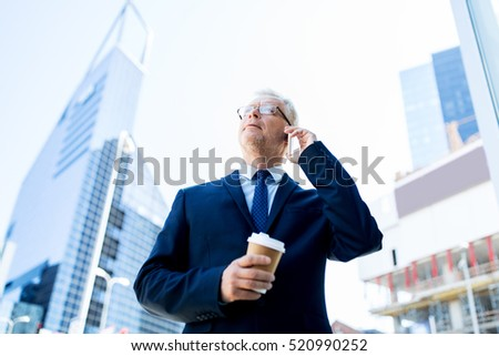 business, technology, communication and people concept - senior businessman with coffee cup calling on smartphone in city