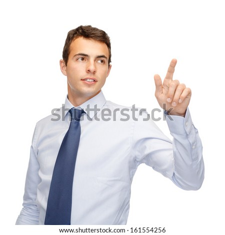 business, technology, communication concept - businessman working with imaginary virtual screen - stock photo