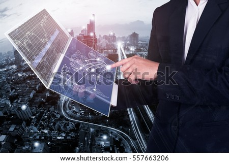business technology concept,businessman working on tablet  with digital layer business  and media diagram,internet of things business
