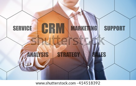 business, technology, internet and customer relationship management concept. Businessman pressing crm button on virtual screens with hexagons and transparent honeycomb - stock photo