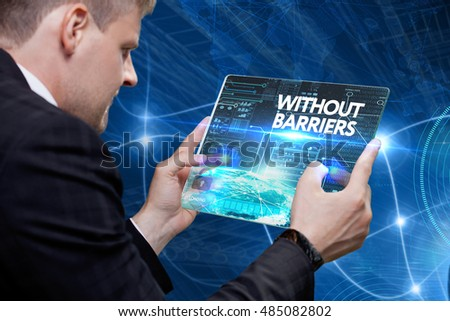 Business, Technology, Internet and network concept. Young business man, working on the tablet of the future, select on the virtual display: Without barriers