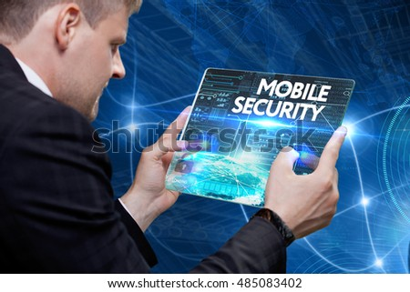 Business, Technology, Internet and network concept. Young business man, working on the tablet of the future, select on the virtual display: Mobile security
