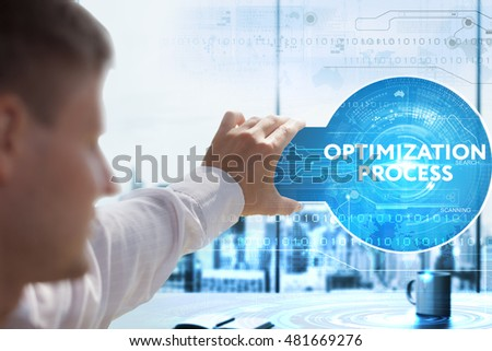 Business, Technology, Internet and network concept. Young businessman looks on a tablet, smart phone of the future. He sees the inscription: optimization process