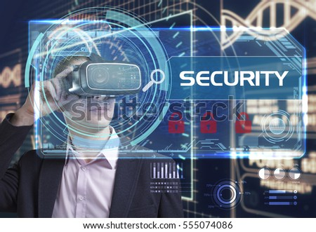 Business, Technology, Internet and network concept. Young businessman working in virtual reality glasses sees the inscription: Security