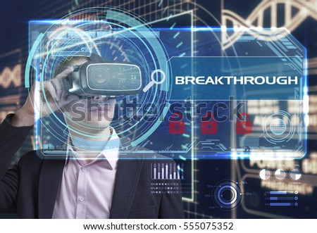 Business, Technology, Internet and network concept. Young businessman working in virtual reality glasses sees the inscription: Breakthrough