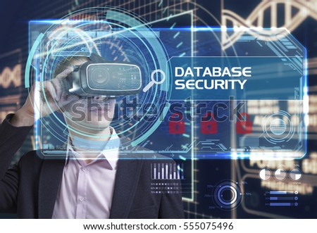 Business, Technology, Internet and network concept. Young businessman working in virtual reality glasses sees the inscription: Database security