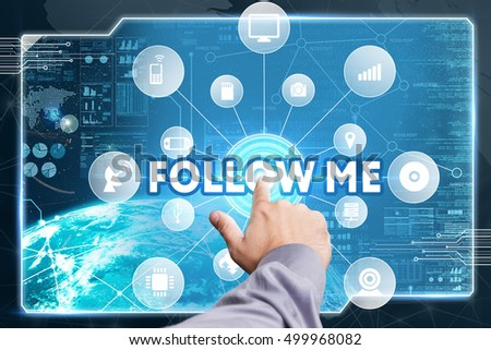 Business, Technology, Internet and network concept. Young businessman working on a virtual screen of the future and sees the inscription: Follow me