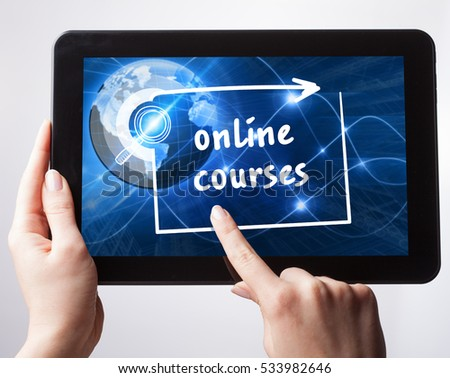 Business, Technology, Internet and network concept. Young businessman, working on the tablet , select on the virtual display: online courses