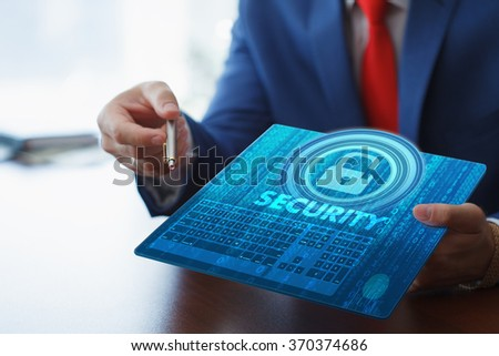 Business, Technology, Internet and network concept. Young businesswoman working on her tablet in the office of the future, select Security on the virtual display. - stock photo