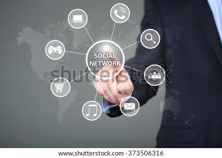 business, technology, internet and networking concept - businessman pressing button with Social Network on virtual screens.  - stock photo