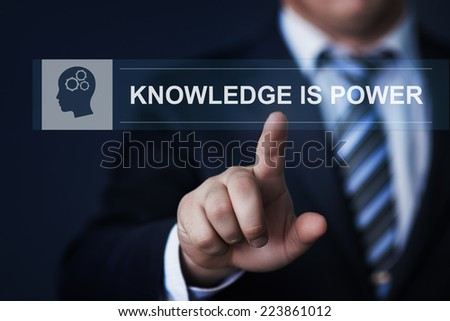 business, technology, internet and networking concept - businessman pressing knowledge is power button on virtual screens - stock photo