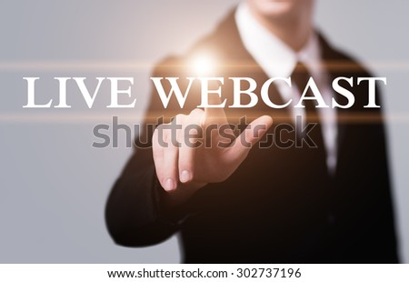 business, technology, internet and networking concept - businessman pressing live webcast button on virtual screens - stock photo