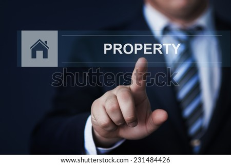 business, technology, internet and networking concept - businessman pressing property button on virtual screens - stock photo