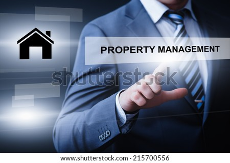 business, technology, internet and networking concept - businessman pressing property management button on virtual screens - stock photo