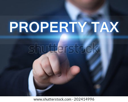 business, technology, internet and networking concept - businessman pressing property tax button on virtual screens  - stock photo