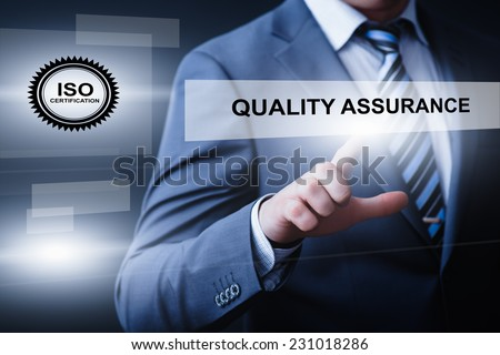 business, technology, internet and networking concept - businessman pressing quality assurance button on virtual screens