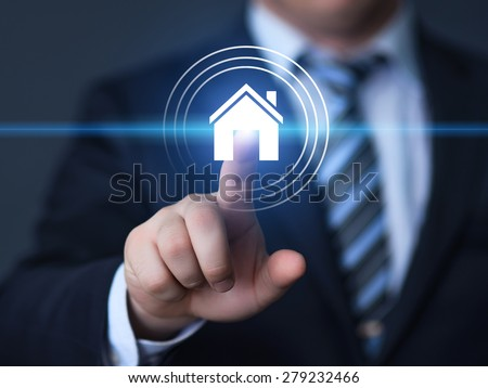 business, technology, internet and networking concept - businessman pressing real estate button on virtual screens - stock photo