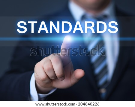 business, technology, internet and networking concept - businessman pressing standards button on virtual screens - stock photo