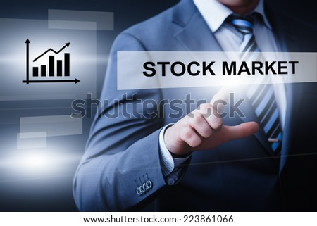 business, technology, internet and networking concept - businessman pressing stock market button on virtual screens - stock photo