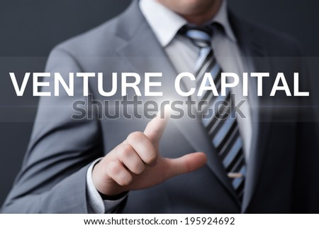 business, technology, internet and networking concept - businessman pressing venture capital button on virtual screens - stock photo