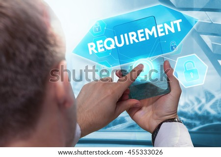 Business, technology, internet and networking concept. Young businessman working on his smartphone in the office, select the icon requirement  on the virtual display.