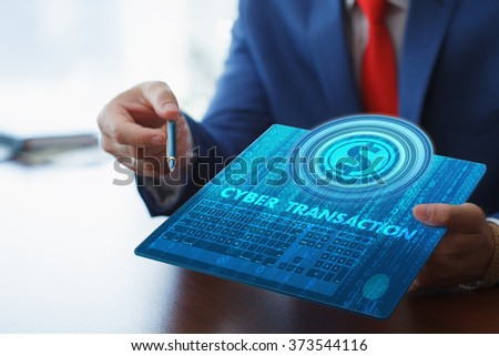 Business, technology, internet and networking concept. Young businessman working on his tablet in the office, select the icon cyber transaction on the virtual display. - stock photo