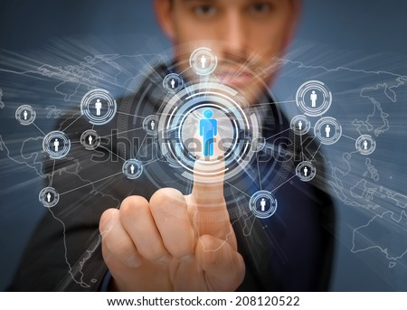 business, technology, internet and social networking concept - businessman pressing button with contact on virtual screens - stock photo
