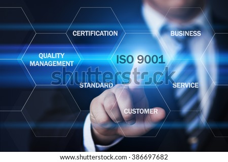 business, technology, internet and virtual reality concept - businessman pressing iso 9001 button on virtual screens with hexagons and transparent honeycomb - stock photo