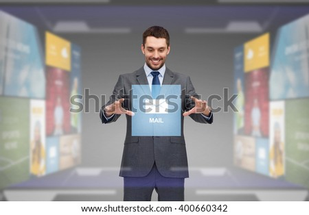 business, technology, multimedia and people concept - smiling businessman working with virtual email icon - stock photo