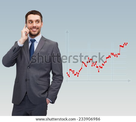 business, technology, people and finances concept - young smiling businessman talking with smartphone over gray background and forex graph going up