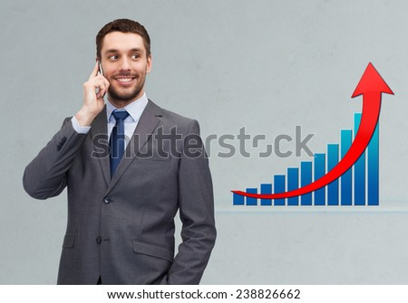 business, technology, people, success and development concept - young smiling businessman calling on smartphone over gray background and growth chart