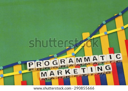 Business Term with Climbing Chart / Graph - Programmatic Marketing - stock photo