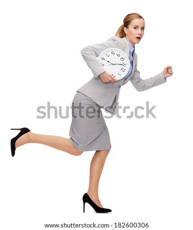 business, time and education concept - stressed young businesswoman with clock running - stock photo