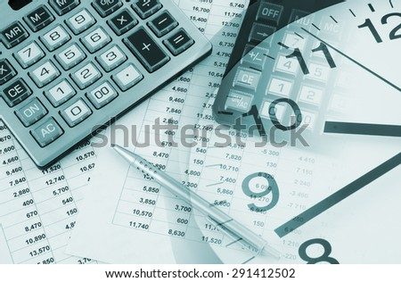 Business time concept, two calculators and pen on financial documents and clock - stock photo