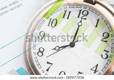 Business time concept with clock and graph documents - stock photo