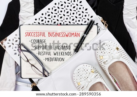 Business tips for successful modern woman,written inside her planner . Top view. - stock photo