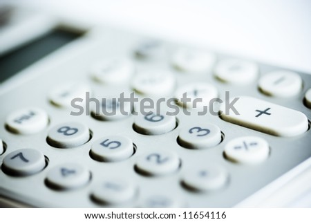 Business tool - selective mood shot of modern calculator. Intentional vignetting and color-tone - stock photo