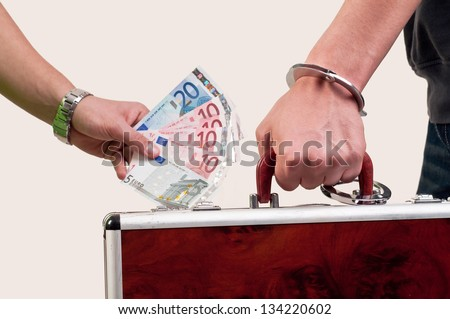 business transfer deal. handover of a suitcase for money - stock photo