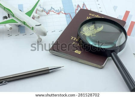 Business travel with toy airplane and passport - stock photo