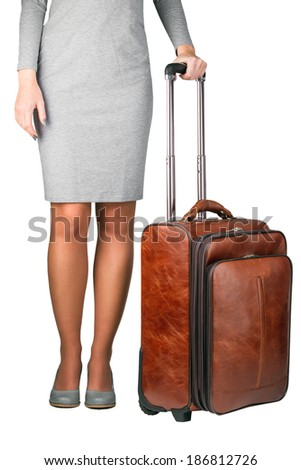 Business travel young woman with case - stock photo