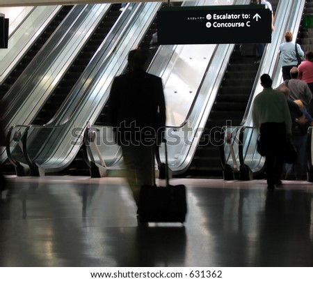 Business traveler gets a workout dashing to the gate - stock photo