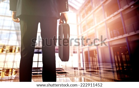business  travelers walking in airport with luggage - stock photo