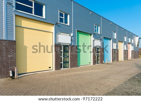 business units for small companies with colorful roller doors - stock photo