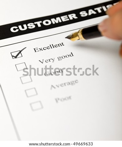 Business values - satisfied customers concept with a survey form - stock photo