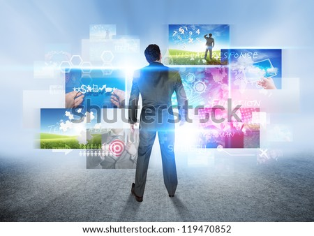 Business Vision - A businessman looking at images. - stock photo
