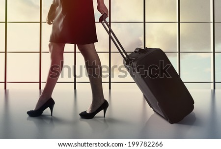 Business woman and airport - stock photo