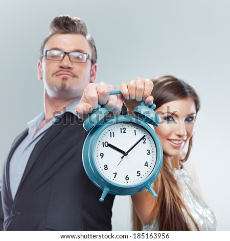 Business woman and business man hold watch. Time concept.